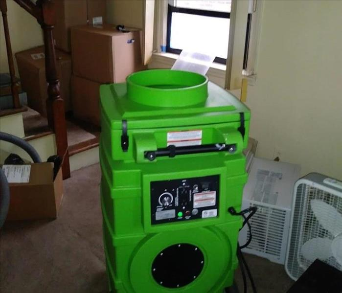 Green equipment set up in common area.