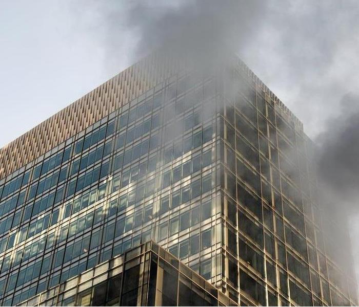 smoke coming out the exterior of a commercial building