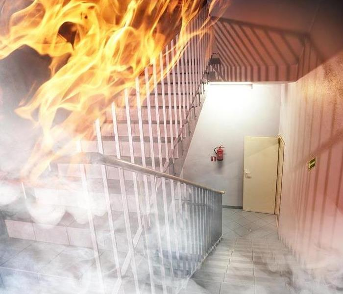 flames in the stairway of a commercial building