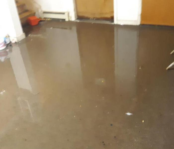 flood water on the concrete floor of a home